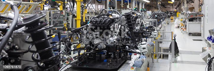 istock Car parts on conveyor. Long format. Wide angle view of plant of automotive industry. Can be used as banner 1093761870