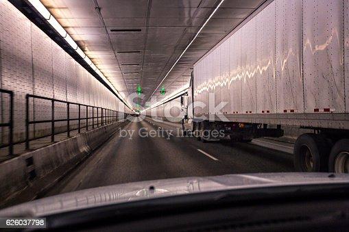 171150458istockphoto Car Passing Trailer Truck Inside Pennsylvania Turnpike Lehigh Road Tunnel 626037798