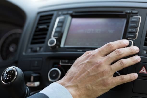 Car. Closeup of a Businessman Using a Car Audio System changing channels stock pictures, royalty-free photos & images