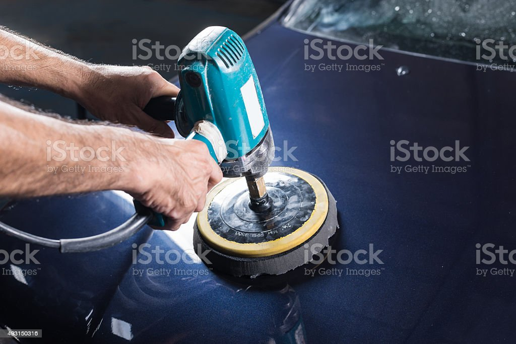 Car polishing series : Polishing blue car stock photo