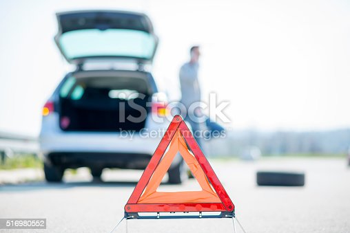 istock Car problems, red warning triangle! 516980552