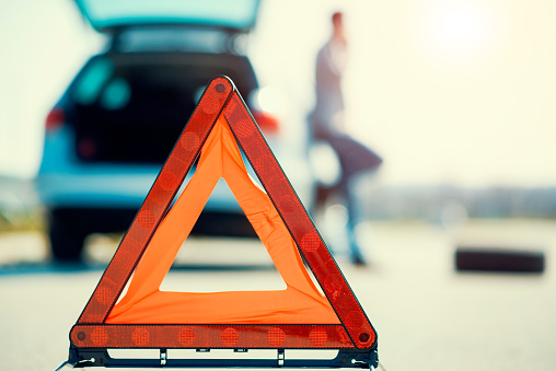 istock Car problems, red warning triangle! 526155526