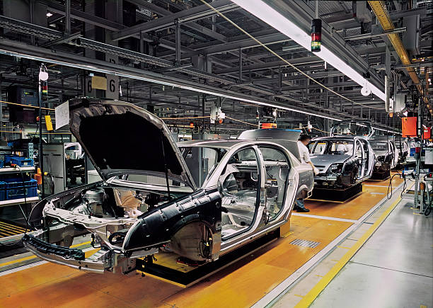 car production line car production line with unfinished cars in a row manufacturing stock pictures, royalty-free photos & images