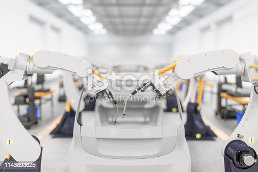 849023956istockphoto Car production line with robotic arm 1143893625