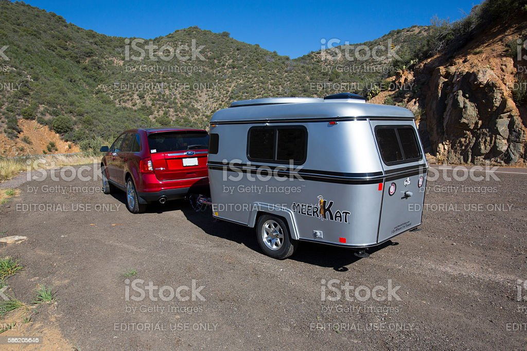 Car pulling Meerkat camper stock photo
