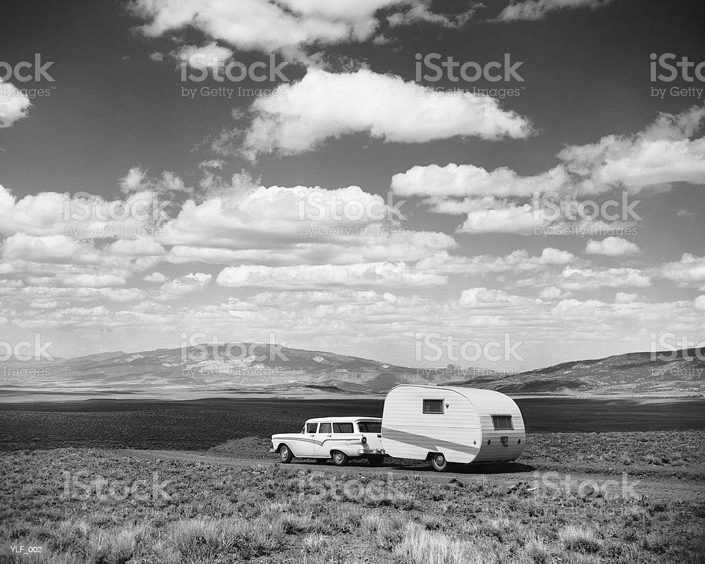 Car pulling trailer on road royalty-free stock photo