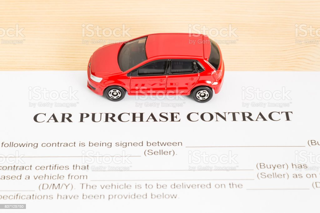 Car Purchase Contract With Red Car on Center stock photo