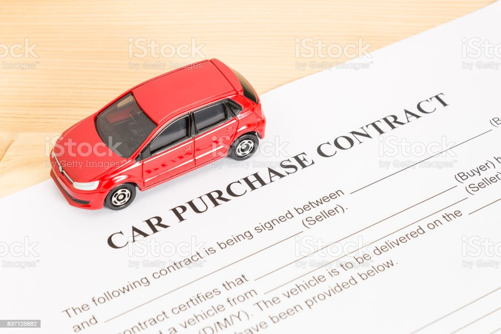 Car Purchase Contract With Red Car on Left View stock photo