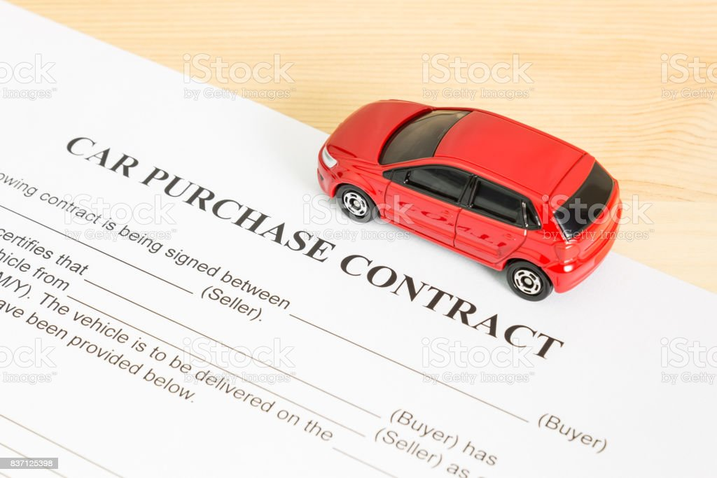 Car Purchase Contract With Red Car on Right View stock photo