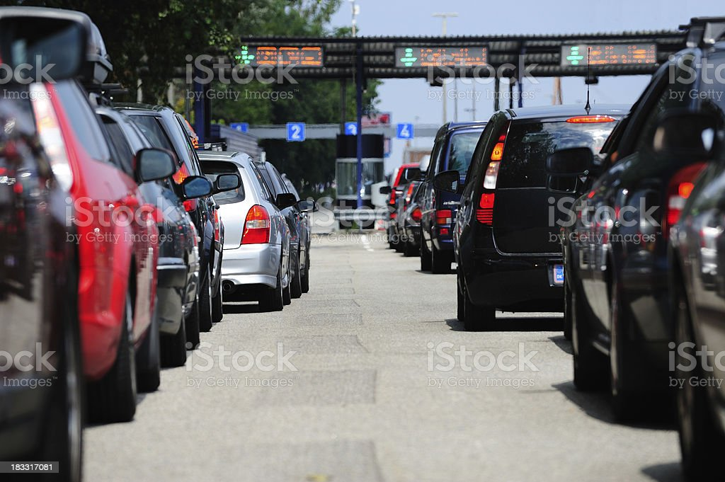 Car queues, waiting to pass road toll stock photo