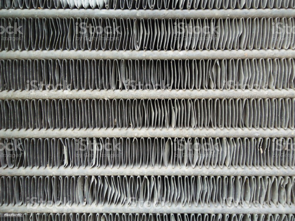 Car radiator honeycomb textured for background. Depth of field stock photo