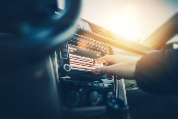 car radio listening - radio station stock photos and pictures