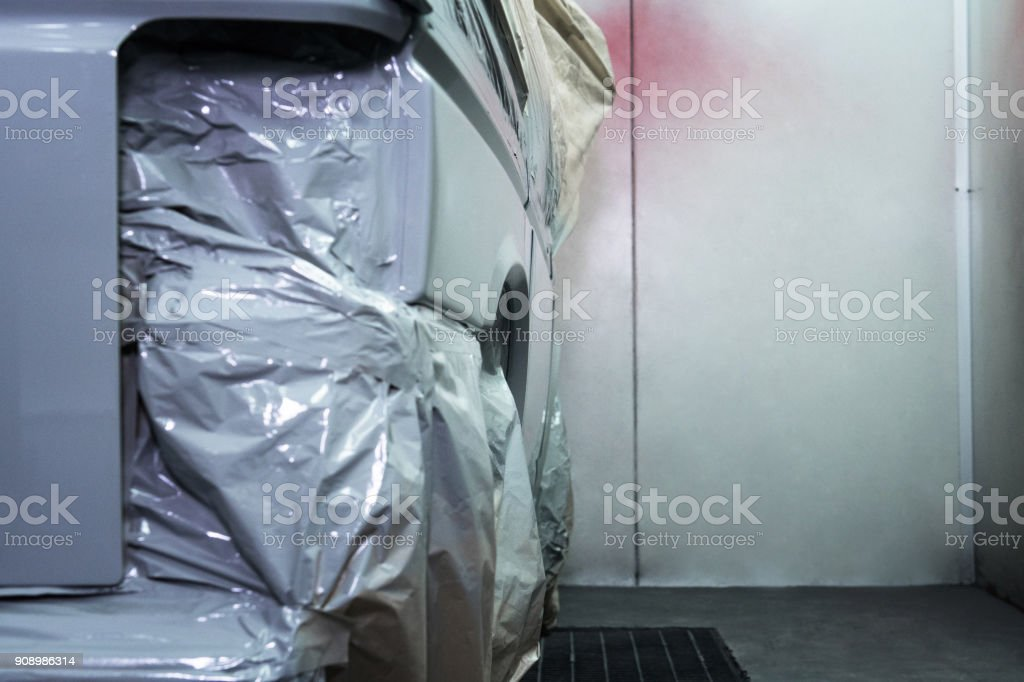 Car ready to repair paint a part in the paint cabin. stock photo