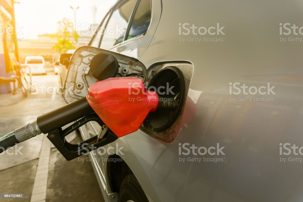 car refilling fuel in petrol station stock photo