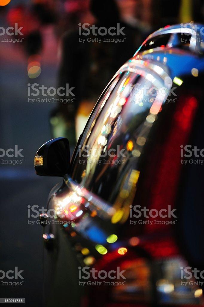 Car reflecting night lights stock photo