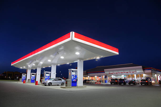 Car Refueling at Gas Station during the Night stock photo