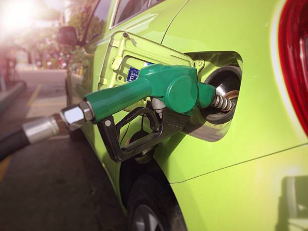 Car refueling at petrol station Fill the machine with fuel or car refueling at petrol station (Selective focus) biodiesel stock pictures, royalty-free photos & images