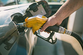 istock Car refueling on petrol station. Man pumping gasoline oil. This photo can be used for automotive industry or transportation concept 867768274