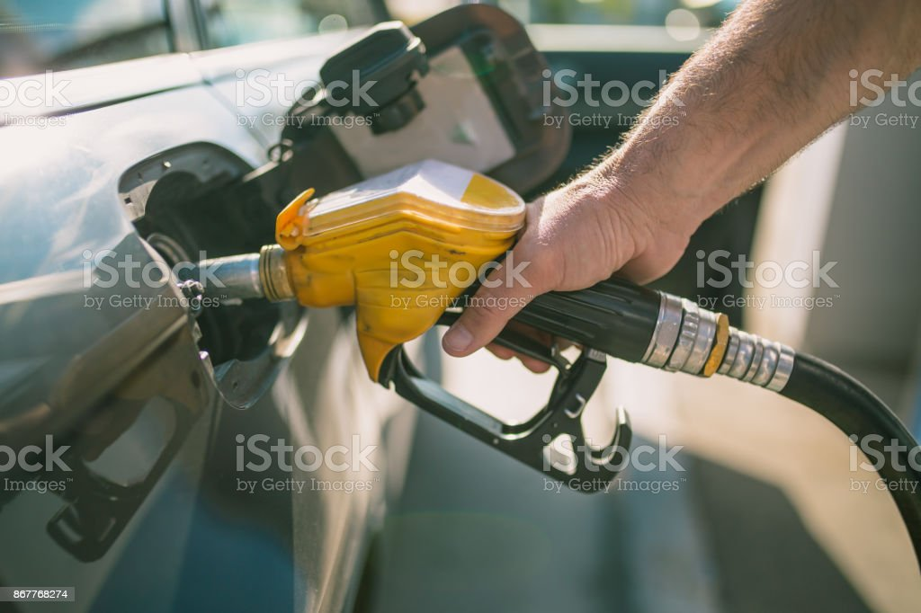 Car refueling on petrol station. Man pumping gasoline oil. This photo can be used for automotive industry or transportation concept stock photo