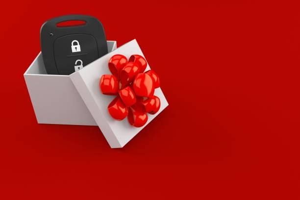 Car remote key inside gift - foto stock