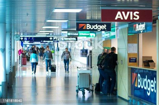 Vantaa, Finland June 12, 2019 - Car rental agencies in Helsinki Airport - Blurred people waitin on the the desk