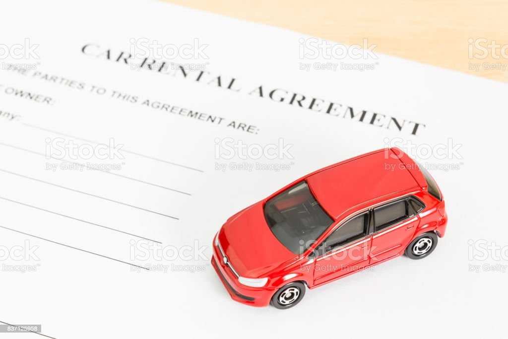 Car Rental Agreement With Red Car at Bottom Right Corner stock photo