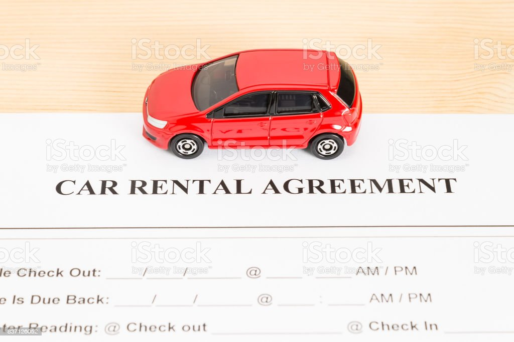 Car Rental Agreement With Red Car on Center stock photo