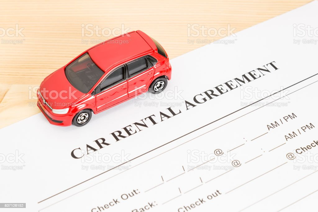 Car Rental Agreement With Red Car on Left View stock photo