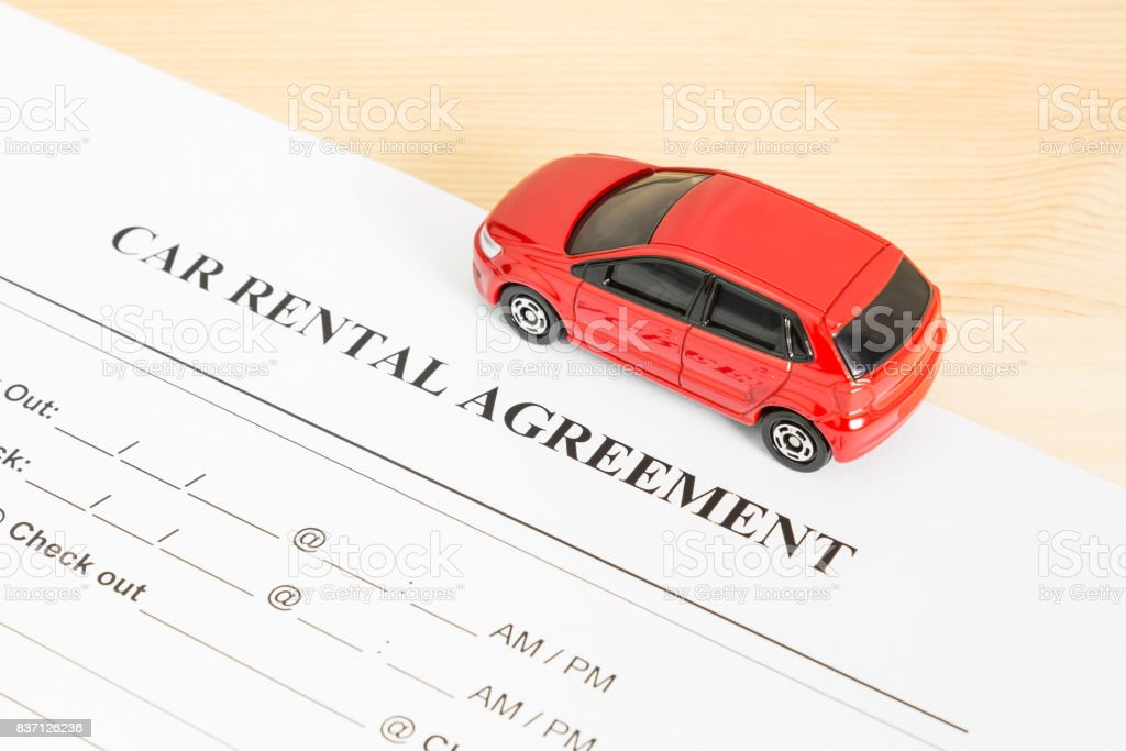 Car Rental Agreement With Red Car on Right View stock photo