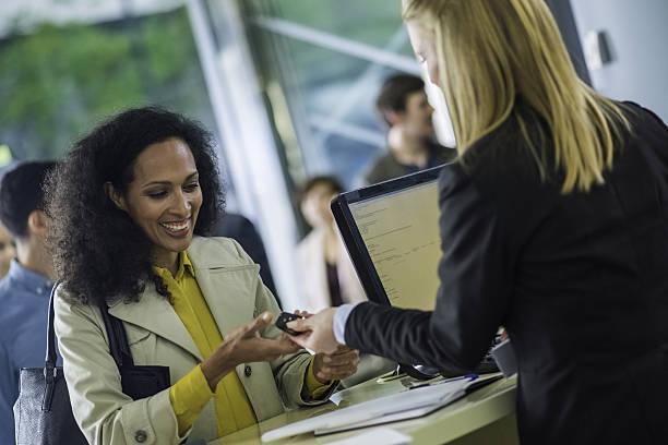 car rental employee giving keys to customer - mietwagen stock-fotos und bilder