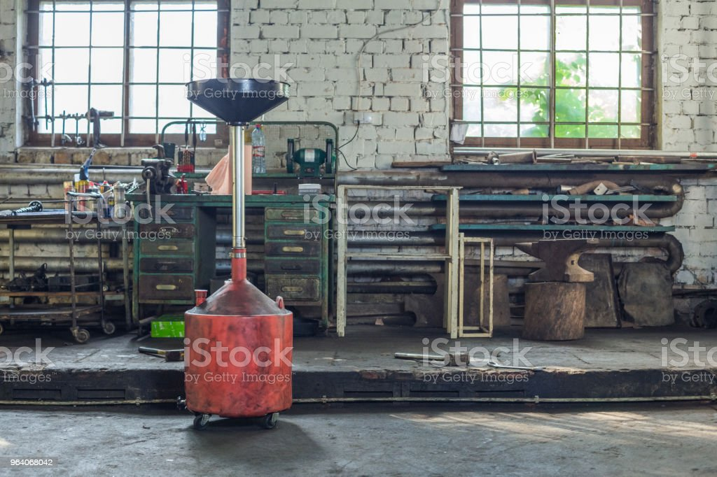 Car repair service, tools, oil an dirty place. - Royalty-free Business Stock Photo