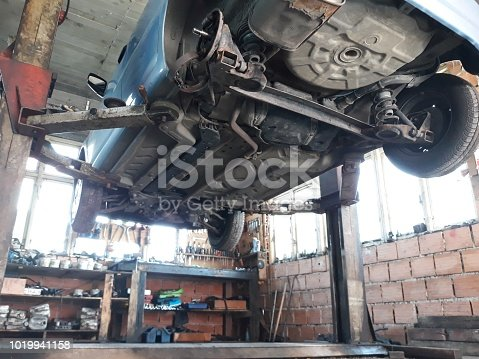 Mechanical Shop with a car on ramp