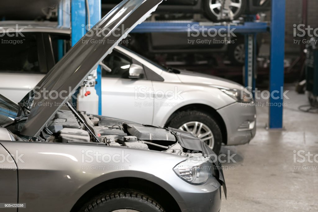 car repair station. cars stand in small service and repair one car. stock photo