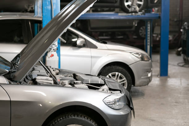 car repair station. cars stand in small service and repair one car. - auto body repair stock photos and pictures