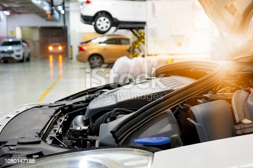 673723668istockphoto car repair station with soft-focus and over light in the background 1080147188