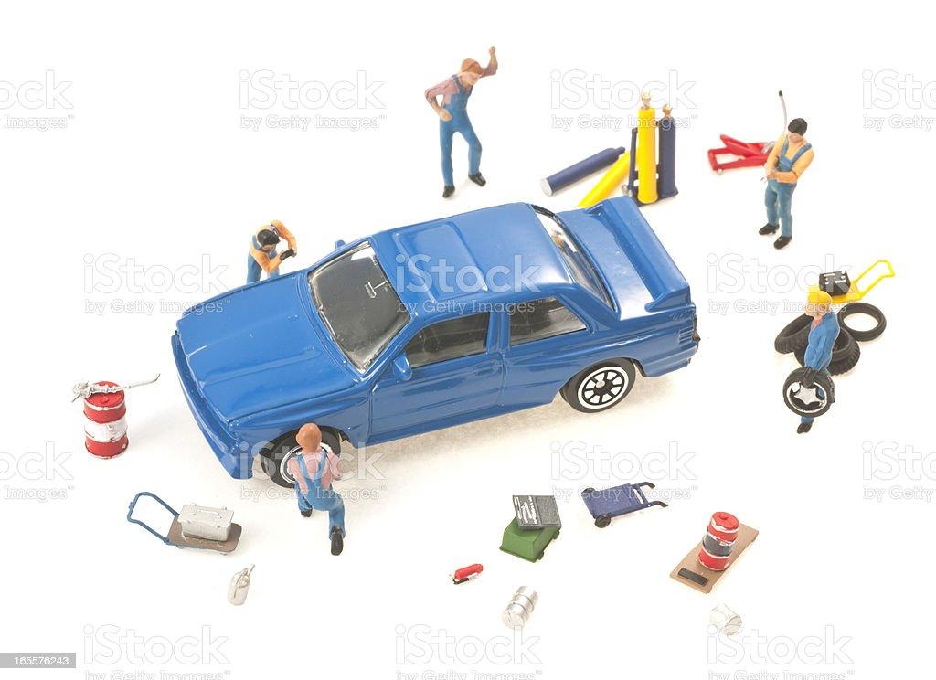 car repair - Werkstatt abstrakt mit Figuren stock photo