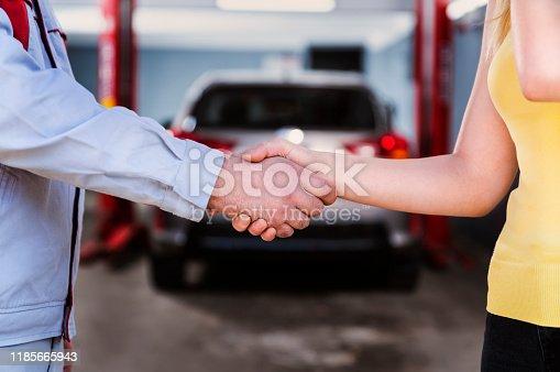 136591855 istock photo Car Repairman is Handshake with Customer in the Auto Repair Shop 1185665943
