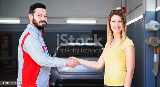 136591855 istock photo Car Repairman is Handshake with Customer in the Auto Repair Shop 1188611114