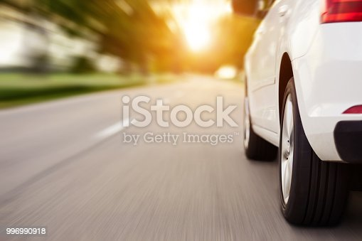 Car ride on road at sunset with copy space, motion blur