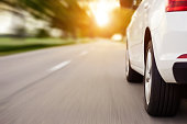istock Car ride on road with copy space, motion blur 996990918