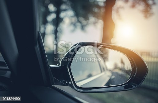 Car Road Trip Concept. Car Driving Conceptual Photo. Outside Mirror.