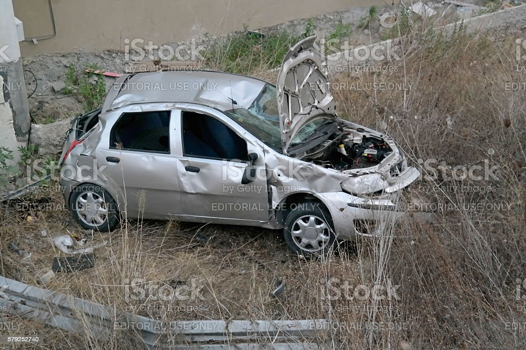 Car roll down after crushing the safety rail stock photo