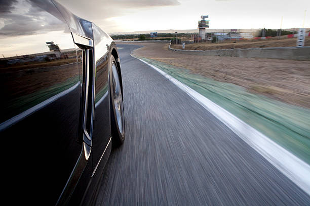 Car running in a racetrack. stock photo