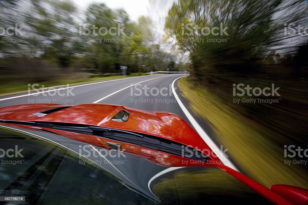 Car running on a road stock photo
