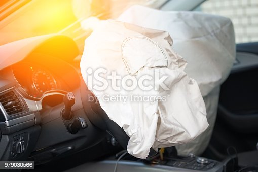 istock Car safety concept: driver's airbag has exploded after an accident 979030566