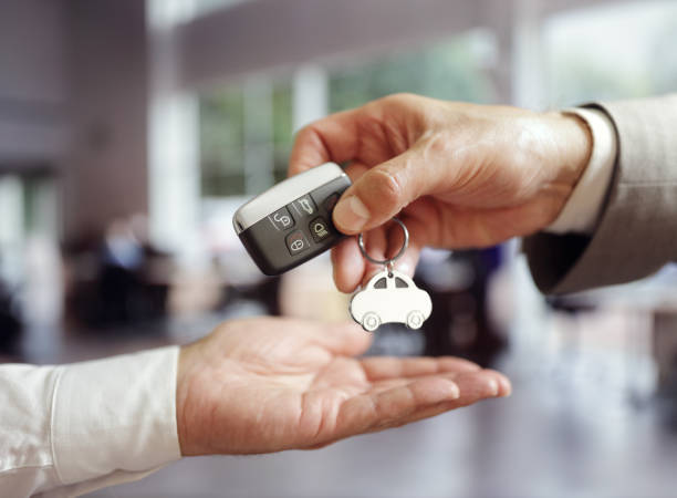 Car sales buying a new car Car sales buying a new car handing over the keys car salesperson stock pictures, royalty-free photos & images