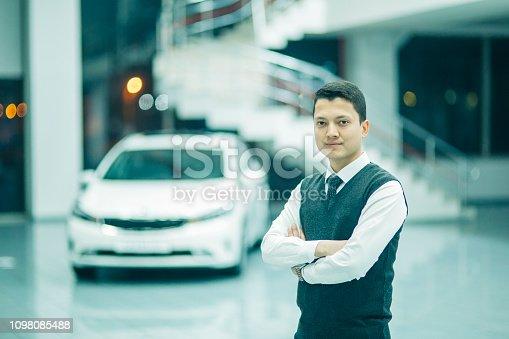 1049198210 istock photo car sales consultant 1098085488