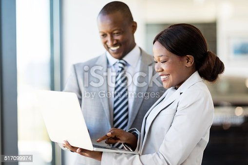 istock car sales consultants working on laptop computer 517099974