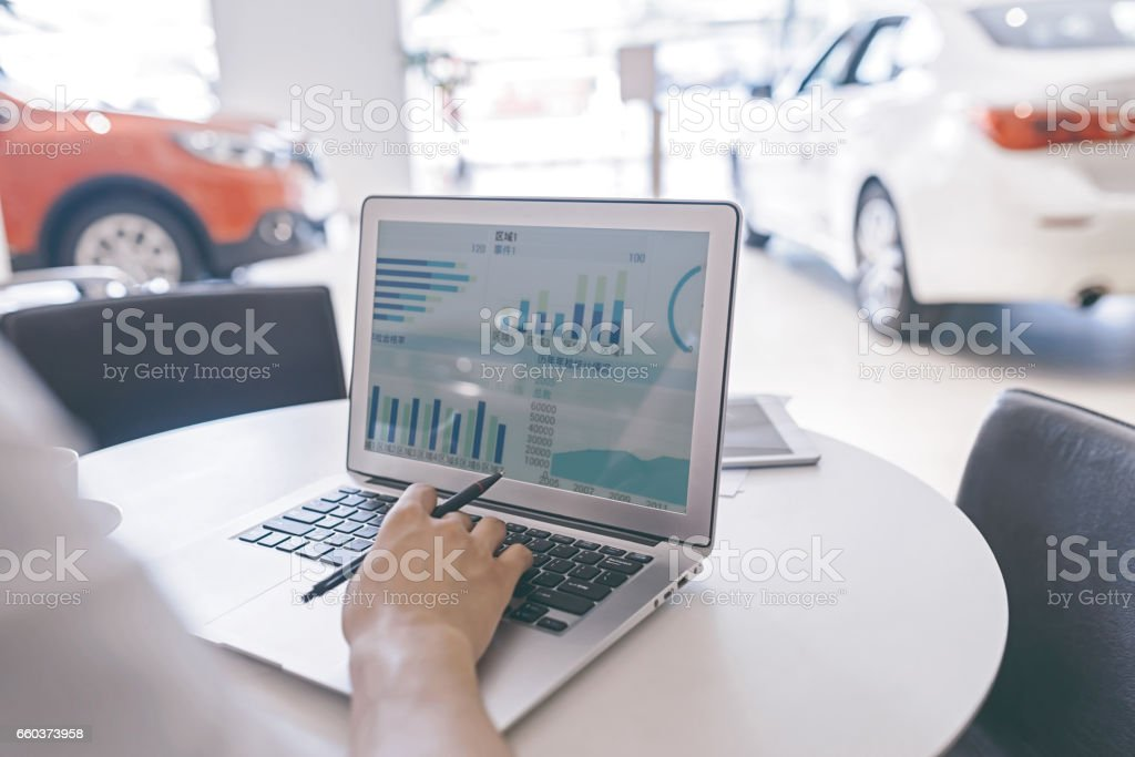 Car sales , the use of laptop orders stock photo