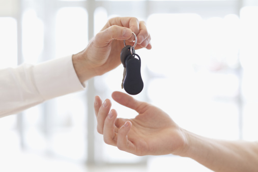 istock Car salesman handing keys to customer 136591822